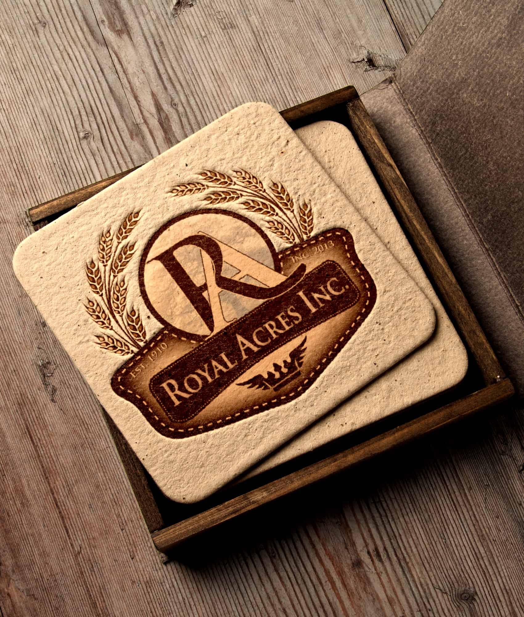 Royal Acres Logo Design printed on cork coasters